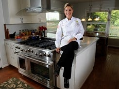 """""""You'll be able to walk in, talk to the appliance, and it will do whatever you ask it to do,"""" Cat Cora says."""