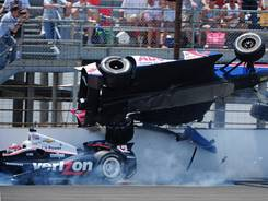 IndyCar driver Mike Conway's car goes airborne over Will Power's car during the Indianapolis 500 this year.