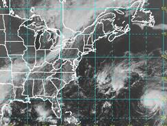 In this satellite image, Tropical Storm Nadine (lower right) is forecast to move out to sea away from the USA.