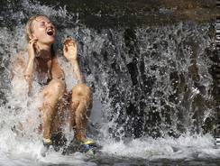 A young woman cools down during a hot summer day near Prague, Czech Republic, in August. Temperatures in eastern Europe were especially warm this summer.