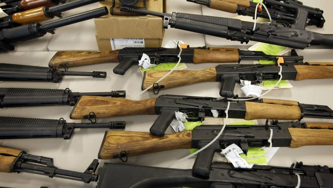 This  Jan. 25, 2011, picture shows part of a cache of seized weapons displayed at an ATF news conference in Phoenix.