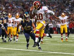 Redskins  quarterback Robert Griffin III scores a touchdown against the Rams at the Edward Jones Dome on Sept. 16.
