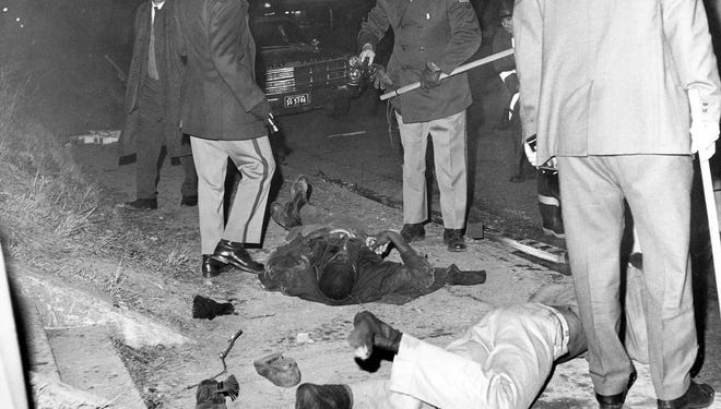 Two black demonstrators who were killed Feb. 8, 1968, in the Orangeburg Massacre lie on the ground.