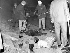 Two black demonstrators who were killed Feb. 8, 1968, in the Orangeburg Massacre lie on the ground.