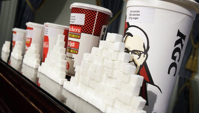 The New York City Board of Health approved a proposal to ban the sale of sugary drinks larger than 16 ounces at city restaurants and other eateries.