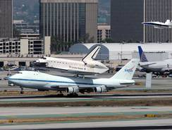 Space shuttle Endeavour, riding atop a modified Boeing 747, lands Friday at Los Angeles International Airport.
