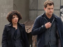 Astrid (Jasika Nicole) and Peter (Josh Jackson) search for Olivia in the 'Fringe' season premiere on Friday.