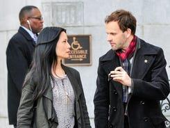 Jonny Lee Miller, right, is Holmes and Lucy Liu is  Watson in CBS' Sherlock update.