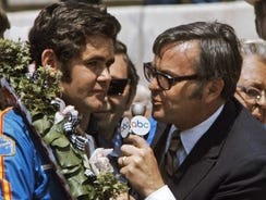 Chris Economaki, interviewing winner Al Unser after  the 1971 Indianapolis 500, worked for ABC, CBS, ESPN and TBS.