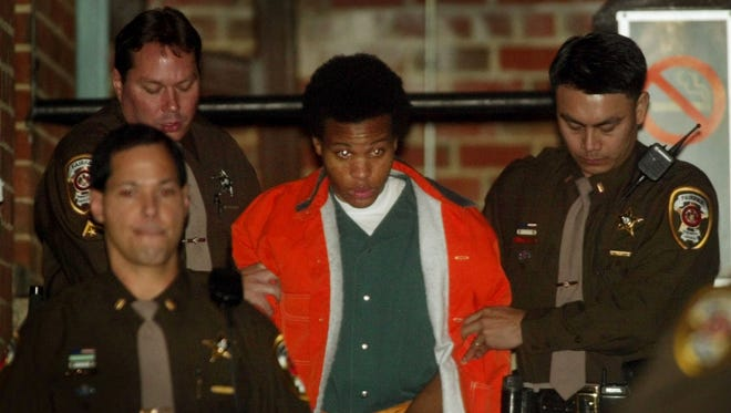 Convicted D.C. sniper Lee Boyd Malvo is escorted from court after his preliminary hearing in Fairfax, Va., on Jan. 14, 2003.