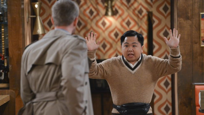 Han (Matthew Moy) reacts after the diner is robbed on '2 Broke Girls,' tonight on CBS.