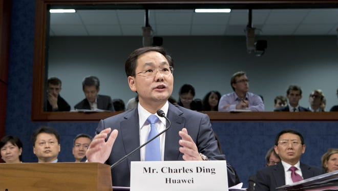 Charles Ding, Huawei's senior vice president for the U.S., testifies on Capitol Hill in Washington, before the House Intelligence Committee as lawmakers probe whether Chinese tech giants' expansion in the U.S. market pose a threat to national security.