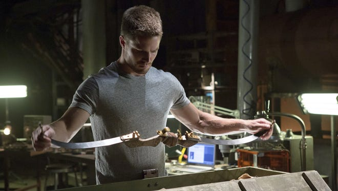 """Oliver Queen (Stephen Arnell) acquaints himself with the tools of his new superhero trade.  Arrow â?"""" â??Lone Gunmanâ? -- Image AR103c_0318b. Pictured: Stephen Amell as Oliver Queen -- Photo: Jack Rowand/The CW -- ©2012 The CW Network. All Rights Reserved."""