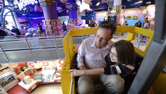 Brian Mansfield and his 10-year-old daughter, Gracelyn, on the Ferris wheel at Toys R Us in Manhattan.