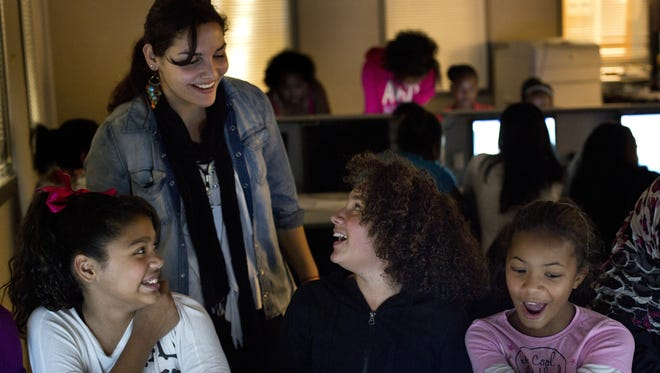 IGNITE alumni Tugba Haklidir, 18, helps the next generation of girls learning about technology.  Sixth graders (left to right) Carrine Jenkins, 11, Gabriella Martinez, 11, and Asia Henphill, 11, enjoyed programming and making the turtle move on screen during IGNITE's programming class at South Shore K-8 School.