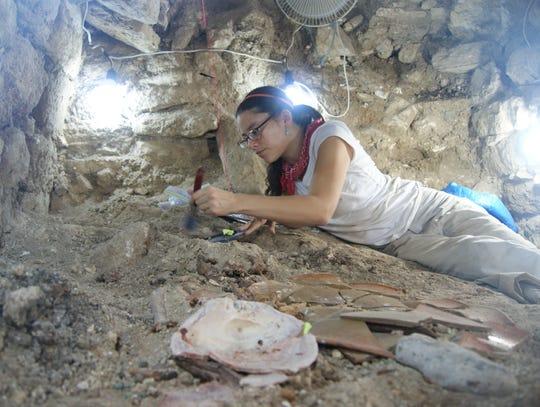 Olivia Farr-Navarro excavating