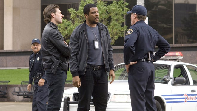 Edward Burns, left,  and Tyler Perry star in the  police procedural thriller 'Alex Cross'