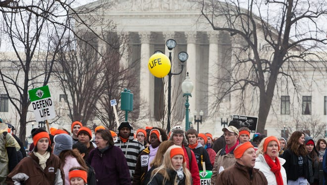 Pro-life activists gather on Jan. 23 near the U.S. Supreme Court in Washington, D.C. Activists on both sides marked the anniversary of the Roe v. Wade decision.