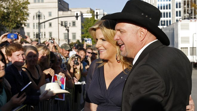 Garth Brooks and Trisha Yearwood greet fans the Country Music Hall of Fame Inductions on Oct. 21 in Nashville.