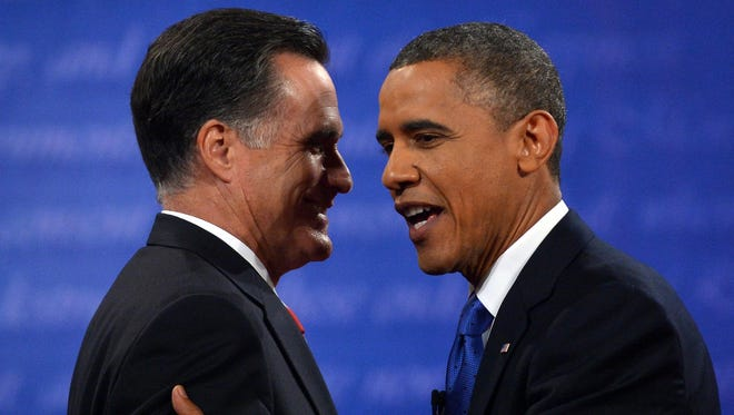 President Obama and Mitt Romney greet each other following the final presidential debate in Boca Raton, Fla., on Monday.