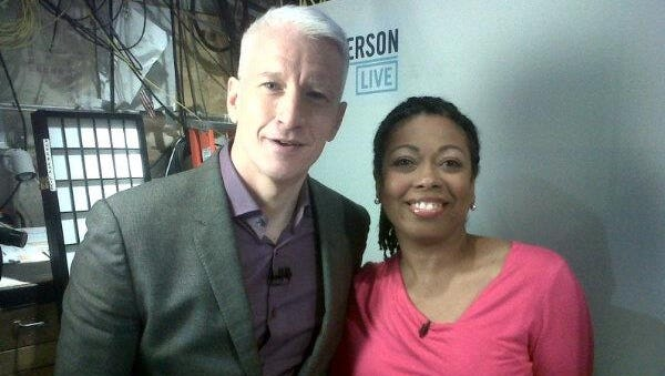 Reporter Melanie Eversley poses with host Anderson Cooper on the set.