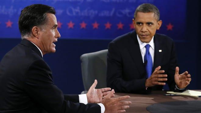 President Obama and Mitt Romney debate in Boca Raton, Fla., on Monday.