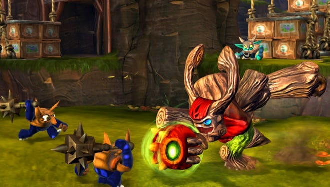 """Kids control Skylander heroes in the new """"Skylanders Giants"""" game from Activision -- a game that lets kids place the toy giant on a peripheral known as the portal to have it morphed into the game and become playable."""