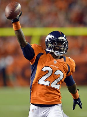Denver Broncos defensive back Tracy Porter  celebrates as he returns an interception for a touchdown in the fourth quarter against the Pittsburgh Steelers at Sports Authority Field in Week 1.