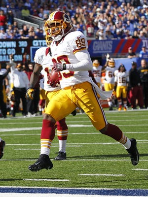 Washington Redskins wide receiver Santana Moss scores touchdown during the first half against the New York Giants at MetLife Stadium on Oct. 21, 2012.
