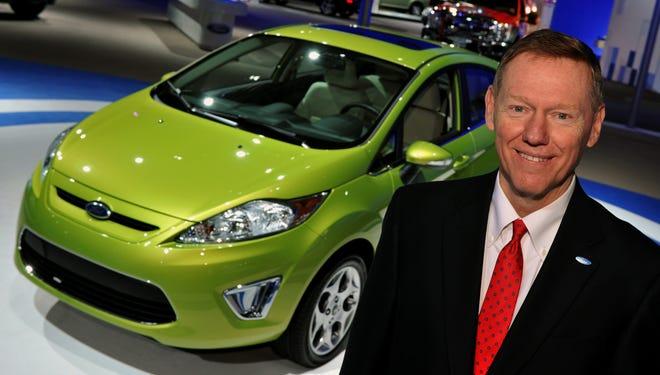 Ford Motor CEO Alan Mulally and Fiesta subcompact.