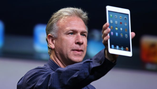 Apple Senior Vice President of Worldwide Marketing Phil Schiller announces much-anticipated iPad Mini during Apple's special event at the California Theatre in San Jose on October 23, 2012 in California.