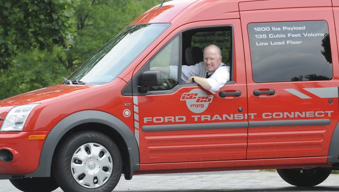 USA TODAY Test Drive columnist James R. Healey in a workin' man's van, in this case a 2010 Ford Transit Connect.