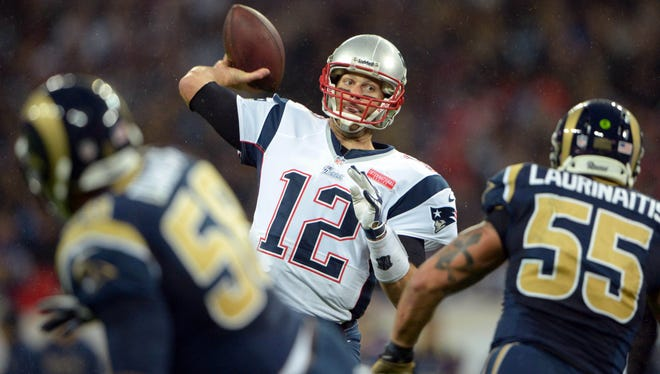 New England Patriots quarterback Tom Brady (12) throws a pass against the St. Louis Rams i at Wembley Stadium in London on Oct. 28, 2012.