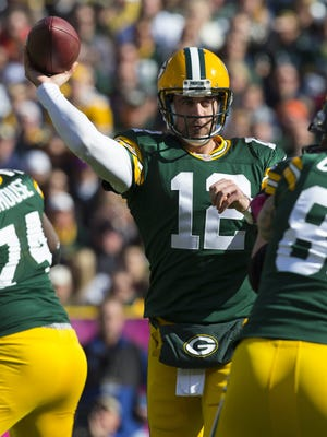 Green Bay Packers quarterback Aaron Rodgers (12) throws a pass during the second quarter against the Jacksonville Jaguars at Lambeau Field on Oct. 28, 2012.