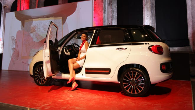 The new, four-door Fiat 500L at a film event in Turin, Italy, in July. The bigger 500, unveiled last March and now on sale in Europe is due in the U.S. in 2013.