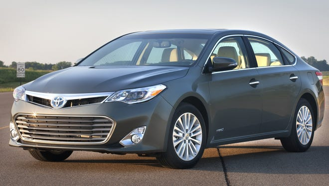Toyota restyled the Avalon sedan for 2013 and added a hybrid version, pictured here.