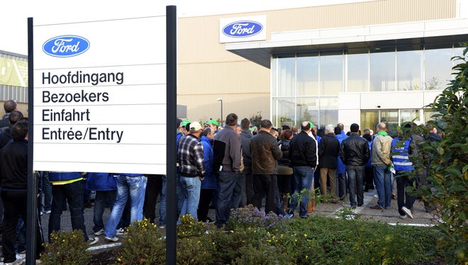 Ford workers block the entry to the plant in Genk, Belgium, which Ford said last week it will close, eliminating 4,300 jobs, to cut losses in Europe.