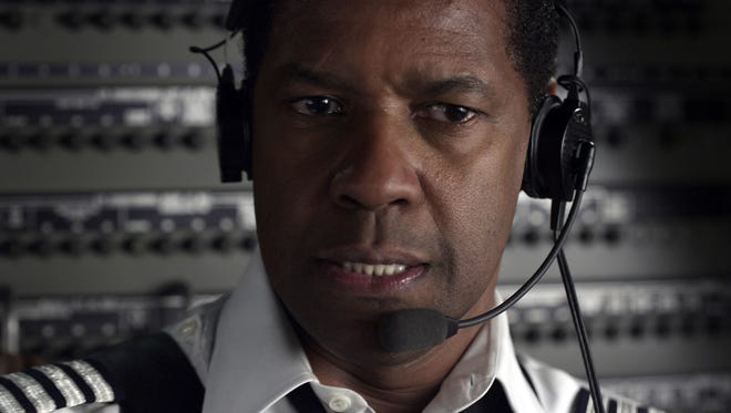 "Denzel Washington plays pilot Whip Whitaker in 'Flight.' ""I know what's happening and I was still tense. It's tense and intense,"" said Washington after viewing the crash sequence at the Los Angeles premiere."