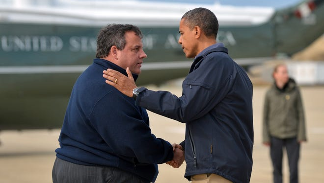 President Obama is greeted by New Jersey Gov. Chris Christie after arriving in Atlantic City on Wednesday to visit areas hit by Sandy.