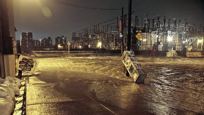 Streets around a Con Edison substation are flooded as the East River overflows into the Dumbo section of Brooklyn, N.Y., Oct. 29, 2012.  Substation flooding complicates electric power restoration.