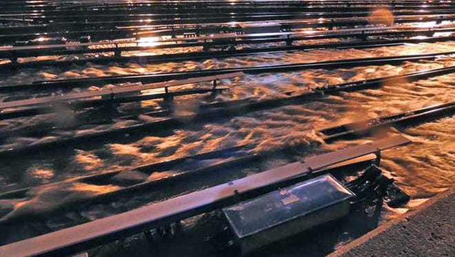In a photo made available by the Metropolitan Transportation Authority on Tuesday, floodwaters stream into the Long Island Rail Road's West Side Yard in New York during superstorm Sandy.
