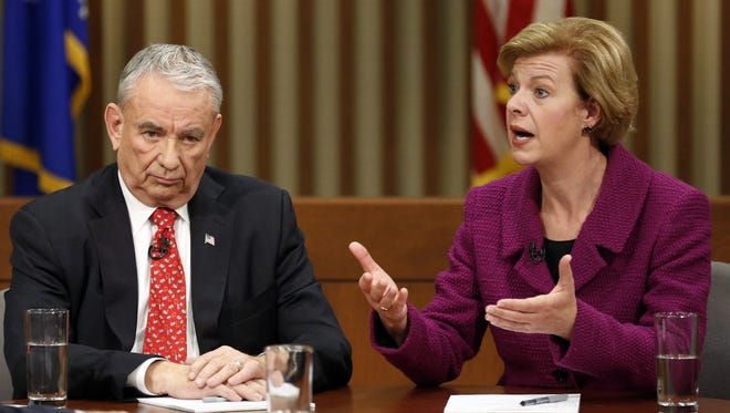 Former Wisconsin governor Tommy Thompson, the state's GOP Senate candidate, and Rep. Tammy Baldwin, the Democratic nominee, debate in Milwaukee on Friday.