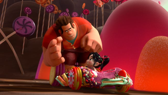 Ralph (voiced by John C. Reilly) and Vanellope Von Schweetz  (voiced by Sarah Silverman) in the game world of Sugar Rush in 'Wreck-It Ralph.'