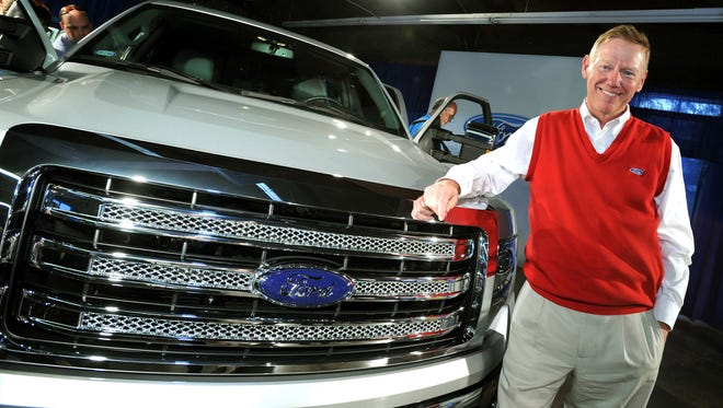 Ford Motor Company CEO Alan Mulally stands with the current F-150 pickup.