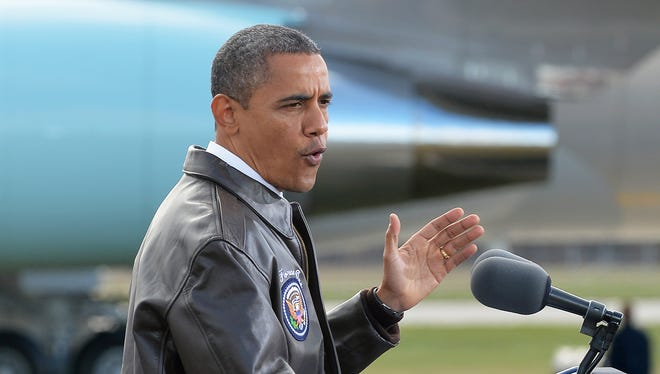 President Obama speaks at a rally on a tarmac of Austin Straubel International Airport in Green Bay, Wis., on Thursday.