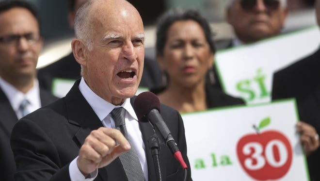 California Gov. Jerry Brown speaks in support of Proposition 30 at an elementary school in San Diego. Proposition 30 would boost the state sales tax for four years and raise income taxes for seven years on those who make more than $250,000 annually.
