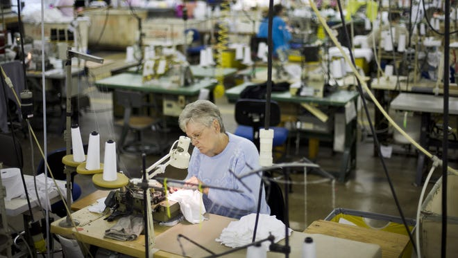 Vanessa Lagola works at a sewing machine at FesslerUSA apparel in Orwigsburg, Pa.