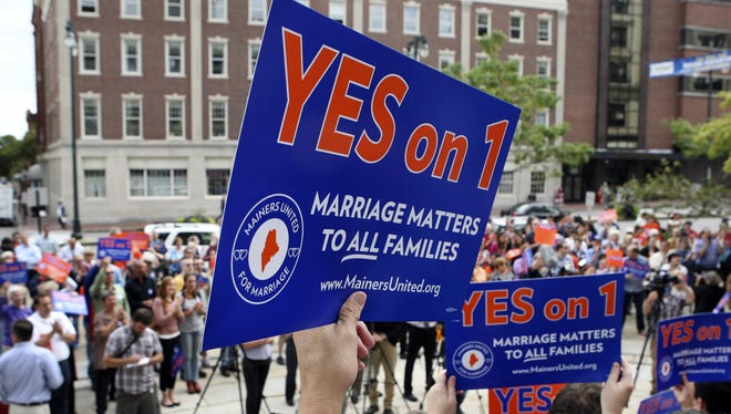 Gay marriage supporters gather at a rally outside of City Hall in Portland, Maine, in support of an upcoming ballot question that seeks to legalize same-sex marriage.