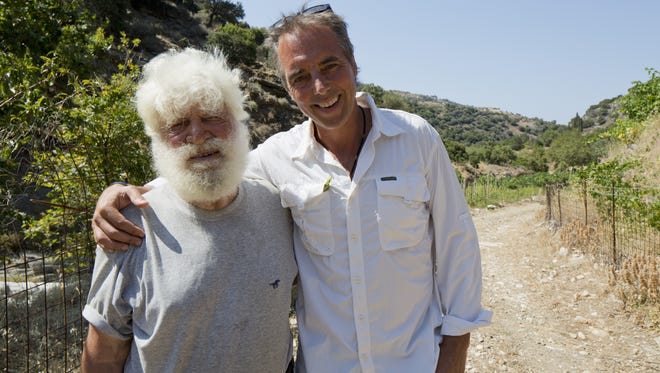Dan Buettner, right, poses with Mihalis Gerakis, 85, of Ikaria, Greece. Buettner has continued his research on longevity and is updating his book 'Blue Zones' with a new chapter.