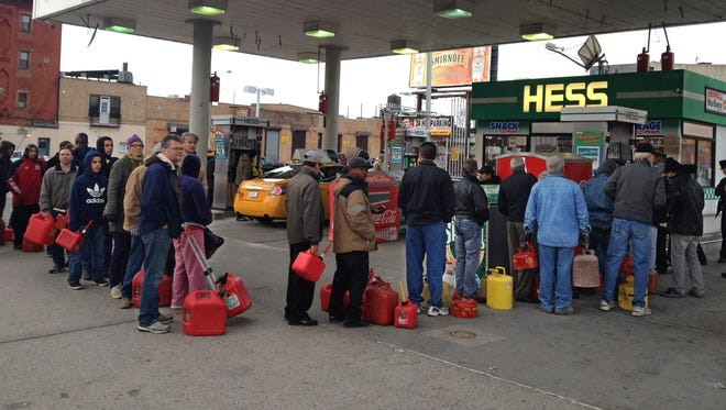 Customers waitat a Hess station where the line of cars snaked 10 blocks in the Gowanus section of  Brooklyn, after Superstorm Sandy.